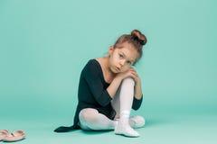 The little balerina dancer on blue background Royalty Free Stock Images