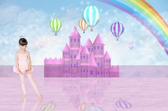 Little balerina in front of a pink fairy castle Royalty Free Stock Image