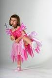 Little Ballerina. Cute toddler girl dancing in a pink ballerina dress royalty free stock image