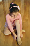 Little ballerina. Putting her shoes, getting ready for practice royalty free stock photos