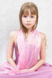 Little ballerina. Pretty girl sits. She wears lilac dress and  pink tippet Stock Photography