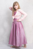 Little ballerina. Pretty girl stays. She wears lilac dress and  pink cardigan Royalty Free Stock Photos