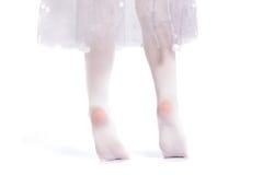 Little ballerina. Little girl practicing ballet.  on white Stock Photography