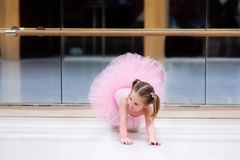 Little ballerina at ballet class. Little ballerina girl in a pink tutu. Adorable child dancing classical ballet in a white studio. Children dance. Kids stock photos