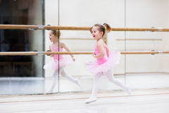 Little ballerina at ballet class. Little ballerina girl in a pink tutu. Adorable child dancing classical ballet in a white studio. Children dance. Kids stock images