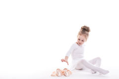 Little Ballerina and ballet shoes on a white background. Stock Photography