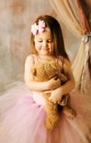 Little ballerina beauty hugging teddy bear Royalty Free Stock Photos