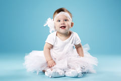 Little ballerina on blue background Stock Image