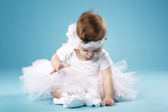 Little ballerina on blue background Royalty Free Stock Photo