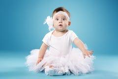 Little ballerina on blue background Stock Photos