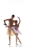 The little ballerina dancing with personal ballet teacher in dance studio. The silhouettes of little ballerina and personal classic ballet teacher in dance stock image