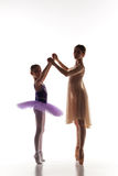 The little ballerina dancing with personal ballet teacher in dance studio Royalty Free Stock Images