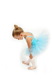 Little Ballerina Feet. Little toddler ballerina looks down and examines her feet royalty free stock photography