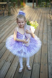 Little ballerina with flowers Stock Photos