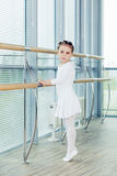 Little ballerina girl. Adorable child dancing classical ballet in a white studio. Royalty Free Stock Photography