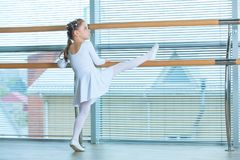 Little ballerina girl in a pink tutu. Adorable child dancing classical ballet in a white studio. Children dance. Kids. Performing. Young gifted dancer in a Stock Photo