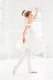 Little ballerina girl in a tutu. Adorable child dancing classical ballet in a white studio. Royalty Free Stock Photos