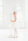 Little ballerina girl in a tutu. Adorable child dancing classical ballet in a white studio. Royalty Free Stock Images
