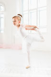 Little ballerina girl in a tutu. Adorable child dancing classical ballet in a white studio. Stock Images