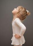 Little ballerina. Graceful little ballerina, grey background Royalty Free Stock Images