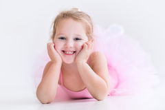 Little ballerina in pink tutu. Little ballerina girl in a pink tutu. Adorable child dancing classical ballet in a white studio. Children dance. Kids performing Royalty Free Stock Image