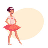 Little ballerina in pink tutu, hands on waist, pointed toe Royalty Free Stock Photos