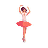 Little ballerina in pink tutu standing on toes hands up Royalty Free Stock Image