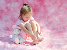 Little ballerina playing stock photo