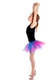 Little ballerina in purple skirt standing on white background Stock Photo