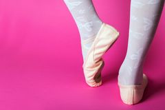 Little ballerina`s legs. In pointe on a pink background. ballet position stock photos