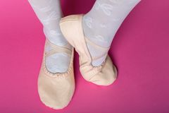Little ballerina`s legs. In pointe on a pink background. ballet position royalty free stock images