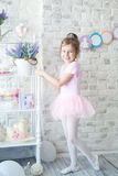 Little ballerina in a studio. With a dessert stand. Girl dreams of becoming ballerina. Girl's birthday party Stock Photos