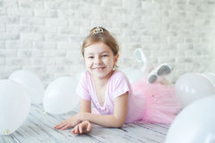 Little ballerina in a studio