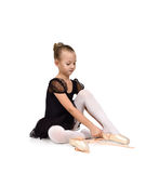 Little ballerina wears ballet shoes Royalty Free Stock Photo