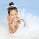 Little ballerina in white dress over blue Royalty Free Stock Photography