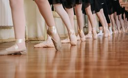 Little ballerinas doing exercises ballet class. Little ballerinas doing exercises in ballet class royalty free stock image