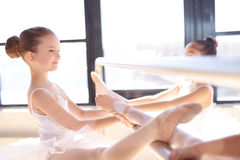 Little Ballerinas Stretching their Legs Using Bar Royalty Free Stock Photos