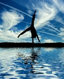 Little ballet dancer make cartwheel Stock Images