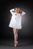 Little ballet dancer posing in white dress Stock Images
