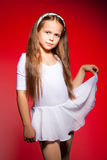 Little ballet dancer on a red background Stock Images