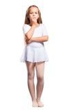 Little ballet dancer on a white Stock Photos