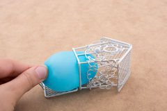 Little balloon placed in a blue color bird house with metal bars Royalty Free Stock Photos