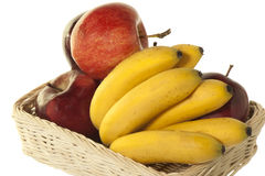 Little bananas and red apples Stock Image