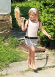 Girl with besom. Little barefoot girl walking with a besom Royalty Free Stock Image