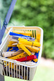 Little basket of clothes pins Stock Photography