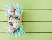 Little basket with easter eggs Royalty Free Stock Photos