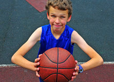 Little basketball player preparing for throwing ball Stock Photography