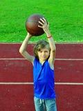 Little basketball player preparing to throw ball Stock Photos