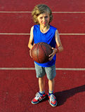 Little basketball player ready for shot Royalty Free Stock Image