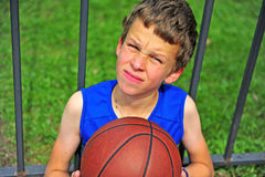 Little basketball player sitting on court Royalty Free Stock Images